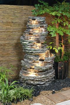 Ilumina tu jard n lamparas funcionales y decorativas - Fuente de pared para jardin ...